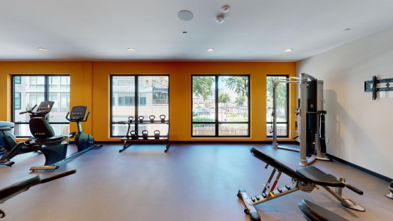 Fitness center with large windows and fitness machines